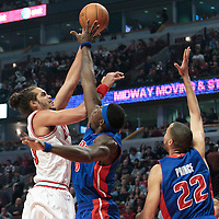30 October 2010: Chicago Bulls Joakim Noah makes a sky hook over Detroit Pistons Ben Wallace during the Chicago Bulls 101-91 victory over the Detroit Pistons at the United Center, in Chicago, Illinois, USA.