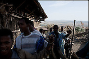"Custom is that during the marriage witnesses of the bride and groom go around the neighboring villages to seek gifts. Two boys are dancing in a house, a local practice to ask food for the marriage's celebration, in which two child brides have just married with boys of 10 years largest. The legal age to get married in Ethiopia is 18, the law is quite often ignored. Education is the most important key to helping end the practice of forced child marriages. Many believe that education may prove to be more successful in preventing child marriages than banning child marriages..North West of Ethiopia, on saturday, Febrary 14 2009.....In a tangled mingling of tradition and culture, in the normal place of living, in a laid-back attitude. The background of Ethiopia's ""child brides"", a country which has the distinction of having highest percentage in the practice of early marriages despite having a law that establishes 18 years as minimum age to get married. Celebrations that last days, their minds clouded by girls cups of tella and the unknown for the future. White bridal veil frame their faces expressive of small defenseless creatures, who at the age ranging from three to twelve years shall be given to young brides men adults already...To protect the identities of the recorded subjects names and specific places are fictional."