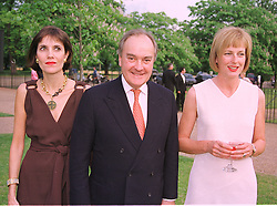 Left to right, LORD & LADY PALUMBO and MISS JULIA PEYTON-JONES Director of the Serpentine Gallery, at a party in London on 7th July 1999.MUC 3