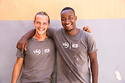 VSO ICS volunteer pair Izak Lees and Nasir Bakari preparing for the VSO ICS Community Action Day CAD held for local members of the community in Y2K Hall Lindi, Lindi region. Tanzania.