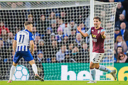 Leondro Trossard (Brighton) looks on as Daniel Drinkwater (Aston Villa) raises his arms during the Premier League match between Brighton and Hove Albion and Aston Villa at the American Express Community Stadium, Brighton and Hove, England on 18 January 2020.