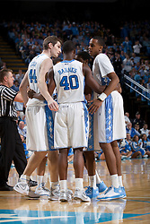 CHAPEL HILL, NC - FEBRUARY 15: Tyler Zeller #44, Harrison Barnes #40 and John Henson #31 of the North Carolina Tar Heels huddle while playing the Wake Forest Demon Deacons at the Dean E. Smith Center in Chapel Hill, North Carolina. North Carolina won 64-78. (Photo by Peyton Williams/UNC/Getty Images) *** Local Caption *** Tyler Zeller;Harrison Barnes;John Henson