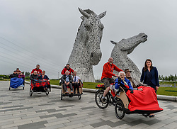 Pictured: Public health and sport minister Aileen Campbell pedals Mary Duncan and Jim Taylor followed by other users.<br /> <br /> Public health and sport minister Aileen Campbell took to the saddle to launch the Scotland-wide rollout of the Cycling without Age service, designed to get older people out and about.<br /> <br /> © Dave Johnston / EEm