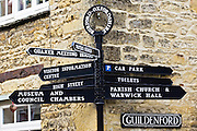 Signpost in Burford in the Cotswolds, points to Visitor Information Centre, Car Park, Church, UK