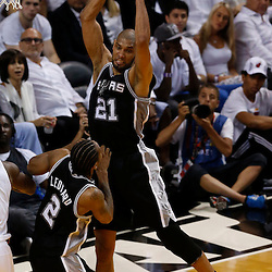 Jun 6, 2013; Miami, FL, USA; San Antonio Spurs power forward Tim Duncan (21) grabs a rebound against the Miami Heat in the second quarter during game one of the 2013 NBA Finals at the American Airlines Arena. Mandatory Credit: Derick E. Hingle-USA TODAY Sports
