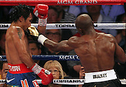 LAS VEGAS, NV - JUNE 09:  (R-L) Timothy Bradley lands a left to the head of Manny Pacquiao during their WBO welterweight title fight at MGM Grand Garden Arena on June 9, 2012 in Las Vegas, Nevada.  (Photo by Jeff Bottari/Getty Images)