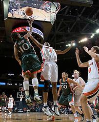 Virginia Cavaliers Center Siedah Williams (4)battles with Miami Hurricanes guard Maurita Reid (10) for rebound.  The University of Virginia Cavaliers defeated the Miami Hurricanes Women's Basketball Team 73-60 at the John Paul Jones Arena in Charlottesville, VA on February 4, 2007.