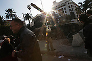 Tunisians take picture of a tank in the center of Tunis.