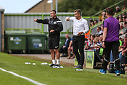 Forest Green Rovers assistant manager, Scott Lindsey and Forest Green Rovers manager, Mark Cooper shout instructions during the EFL Sky Bet League 2 match between Forest Green Rovers and Barnet at the New Lawn, Forest Green, United Kingdom on 5 August 2017. Photo by Shane Healey.