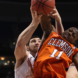 Mar 17, 2011; Tampa, FL, USA; West Virginia Mountaineers forward Deniz Kilicli (13) draws a foul from Clemson Tigers guard Andre Young (11) during the second half of the second round of the 2011 NCAA men's basketball tournament at the St. Pete Times Forum. West Virginia defeated Clemson 84-76.  Mandatory Credit: Derick E. Hingle