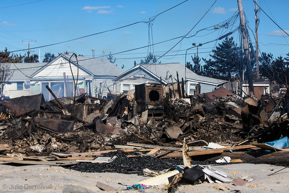 Brick Beach, New Jersey, November 3, 2012, a fire smolders days after it started following Hurricane Sandy. Firemen were unable to reach a fire caused by a gas leak following the storm surge produced by Sandy. <br />  The Jersey shore took the brunt of Hurricane Sandy.