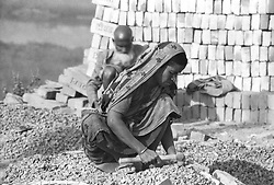 BANGLADESH DHAKA OCT94 - A woman labourer crushes bricks by the roadside in Dhaka, Bangladesh. Smashing bricks in order to obtain gravel is a common occupation in Bangladesh which is largely devoid of natural stones...jre/Photo by Jiri Rezac..© Jiri Rezac 1994