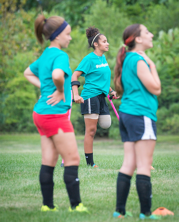 Only weeks after loosing her leg, Jade DiSanti takes the soccer field during a practice in Delran, NJ  Wednesday, August 20, 2014   (PHOTO Bryan Woolston / @woolstonphoto)