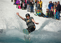 Audrey Beaulac makes a splash during the annual B.Y.O.D.C. Pond Skim at Gunstock Mountain as they close out their 2017 season on Sunday afternoon.  (Karen Bobotas/for the Laconia Daily Sun)