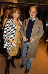 Actor JOHN STANDING and his wife SARAH at the launch of Dunhill by Design by Nick Foulkes held at Alfred Dunhill, 48 Jermyn Street, London on 24th October 2006.<br />