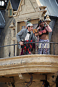 Members of the Royal De Luxe acting on the balcony by the side of the gigantic mechanical elephant in central London, on Friday, May 5, 2006. The Sultan's Elephant show, for the first time in London is a magical, and unique in the world, theatrical show across the streets, performed by an international French company - Royal De Luxe - specialised in constructing and giving 'life' to enormous mechanical puppets. The Sultan's Elephant is the story of a Sultan dreaming of a little girl that travels through time. **ITALY OUT**