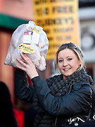 Repro Free: 05/12/2012.23 year old student Gill Conway from Rathfarnham brings home the turkey as Betfair gave away 150 free turkeys to members of the public as part of their ?Beat the Budget? giveaway on Dublin's Camden street. Pic Andres Poveda.