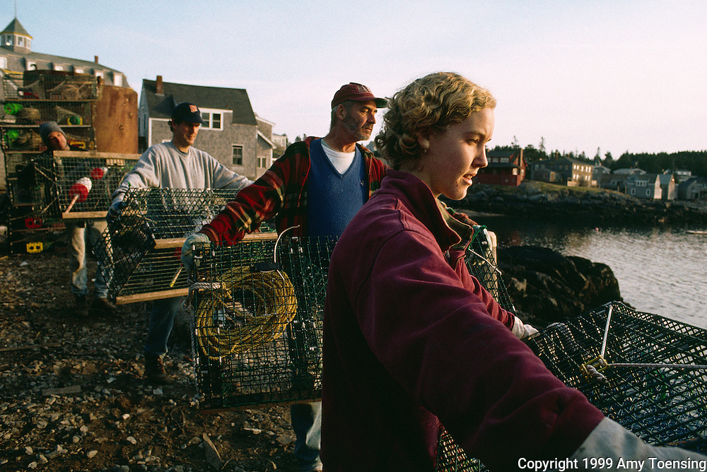 MONHEGAN ISLAND, MAINE - DECEMBER 03: Residents and lobstermen alike help on trap day to get all the lobster traps out to sea for the year, December 3, 1999 on Monhegan Island, Maine. Monhegan Island, home to lobstermen and painters and a popular destination for tourists is twelve miles off the coast of Maine. Ringed by high, dark cliffs, its interior a mix of meadows, marsh and spruce groves, Monhegan is one of just 14 true island communities left off the coast of Maine. The island has a 65 permanent, year-round residents and the population grows to around 200 in the summer, with day-trippers adding several hundred more. (Photo by Amy Toensing). _________________________________________<br />