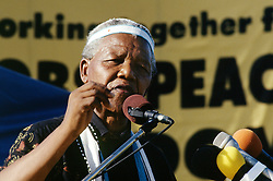 NELSON ROLIHLAHLA MANDELA (July 18, 1918 - December 5, 2013), 95, world renown civil rights activist and world leader. Mandela emerged from prison to become the first black President of South Africa in 1994. As a symbol of peacemaking, he won the 1993 Nobel Peace Prize. Joined his countries anti-apartheid movement in his 20s and then the ANC (African National Congress) in 1942. For next 20 years, he directed a campaign of peaceful, non-violent defiance against the South African government and its racist policies and for his efforts was incarcerated for 27 years. Remained strong and faithful to his cause, thru out his life, of a world of peace. Transforming the world, to make it a better place. PICTURED: NELSON MANDELA at a rally, 1994, South Africa.  (Credit Image: © Greg Marinovich/ZUMA Wire/ZUMAPRESS.com)