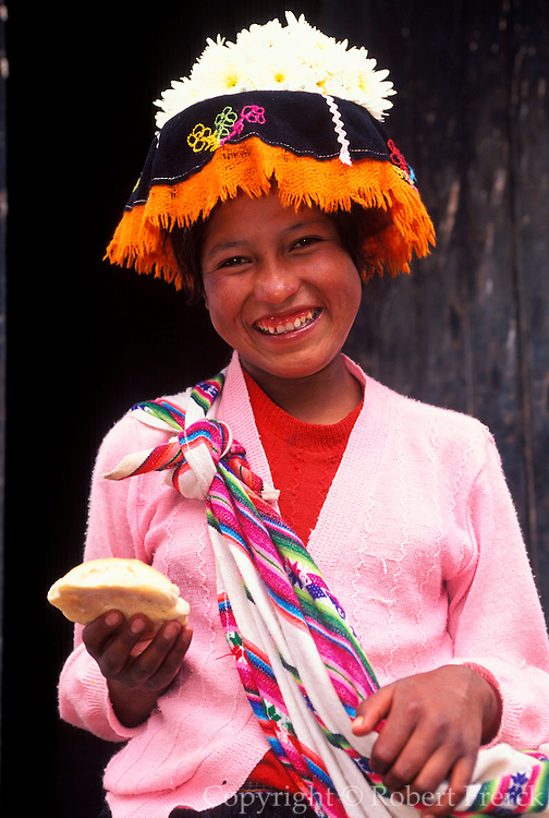 PERU, HIGHLANDS, MARKETS Pisac; Quechua girl selling bread