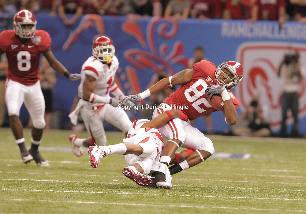 2 January 2009: Utah cornerback RJ Stanford (25) tackles Alabama wide receiver Earl Alexander (82) during a 31-17 win by the Utah Utes over the Alabama Crimson Tide in the 75th annual Allstate Sugar Bowl at the Louisiana Superdome in New Orleans, LA.