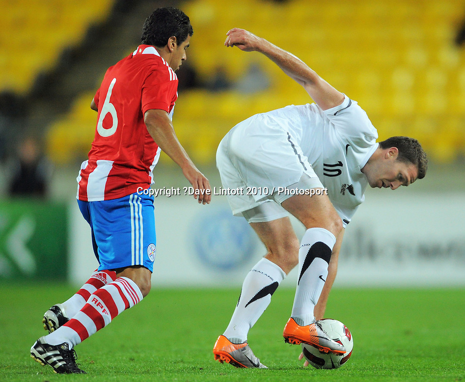 NZ's Chris Killen tries to control the ball under pressure from Carlos Bonet. International football friendly - New Zealand All Whites v Paraguay at Westpac Stadium, Wellington on Tuesday, 12 October 2010. Photo: Dave Lintott / photosport.co.nz