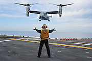 An MV-22 Osprey assigned to Marine Medium Tiltrotor Squadron (VMM) 166 approaches the amphibious assault ship USS Makin Island (LHD 8). This is the first time an Osprey has conducted flight operations on a west coast amphibious assault ship since being introduced to the fleet. (U.S. Navy photo by Chief Mass Communication Specialist John Lill/Released)