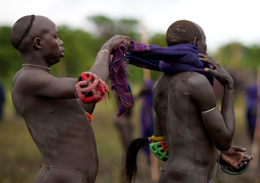 Most of the warriors use no protection at all and fight completely naked in order to show their bravery. The neck and head are the most vulnerable parts of the body. One of the main Surma / Suri customs is stick fighting. This ritual and sport is called Donga or Sagenai (Saginay). Donga is both the name of the sport and the stick, whereas sagenai is the name of the stick-fighting session. Stick fighting is basic in Suri culture. In most cases, stick fighting is a way for warriors to find girlfriends, it can also be a way to settle conflicts. On this occasion men  show their courage, their virility and their resistance to pain, to the young women. The fights are held between Suri villages, and begin with 20 to 30 people on each side, and can end up with hundreds of warriors involved.