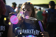 "06212016 - Noblesville, Indiana, USA: A Dead and Company fan wearing a shirt reading, ""Pranksters Not Gangsters,"" blows bubbles on ""Shakedown Street"" in the parking lot of Klipsch Music Center (Deer Creek) before members of the Grateful Dead perform as Dead and Company. The Grateful Dead's final show at  Deer Creek in July 1995 was marred by over a thousand fans crashing the gates leading to the next day's show being canceled. Grateful Dead guitarist Jerry Garcia died a few weeks later. (Jeremy Hogan/Polaris)"