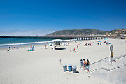 Morning at Avila Beach, California, USA. People arriving to swim, relax, sunbathe.