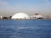 Photograph of the former Spruce Goose hangar and the Queen Mary taken on a Long Beach Harbor and Los Angeles Harbor boat cruise on March 2, 2013 in Long Beach, California. ©Paul Anthony Spinelli