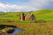 Willow Creek Barn with the Beartooth Mountains near Cooney, Montana, USA