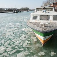 VENICE, ITALY - FEBRUARY 05:  A boat is nearly blocked by ice in the North side of the frozen Venice Lagoon on February 5, 2012 in Venice, Italy. Italy as most of Europe is under a spell of very cold weather, it is more than 20 years aince the Venice Lagoon last froze.  (Photo by Marco Secchi/Getty Images)