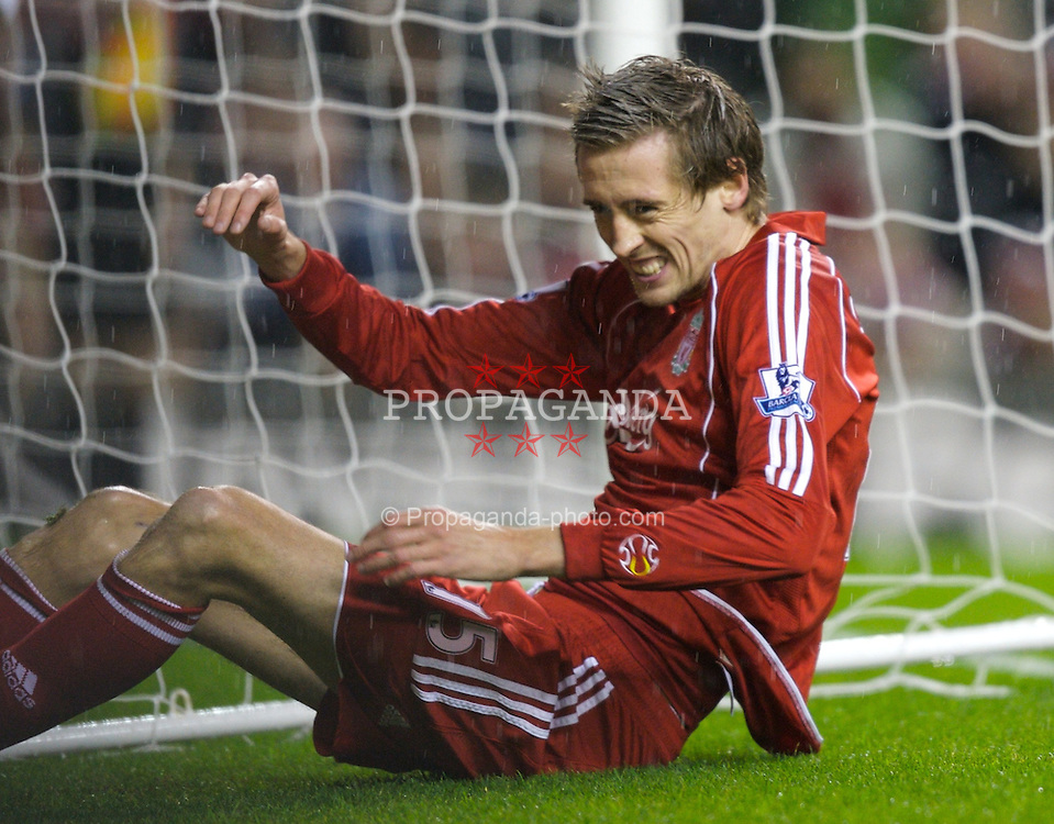 LIVERPOOL, ENGLAND - Tuesday, January 15, 2008: Liverpool's Peter Crouch lies on the floor after missing a chance against Luton Town during the FA Cup 3rd Round Replay at Anfield. (Photo by David Rawcliffe/Propaganda)