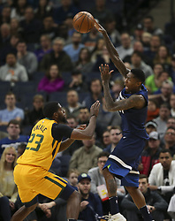 April 1, 2018 - Minneapolis, MN, USA - Minnesota Timberwolves guard Jamal Crawford (11) passes off after drawing the defense of Utah Jazz forward Royce O'Neale (23) in the first quarter on Sunday, April 1, 2018 at Target Center in Minneapolis, Minn. (Credit Image: © Jeff Wheeler/TNS via ZUMA Wire)
