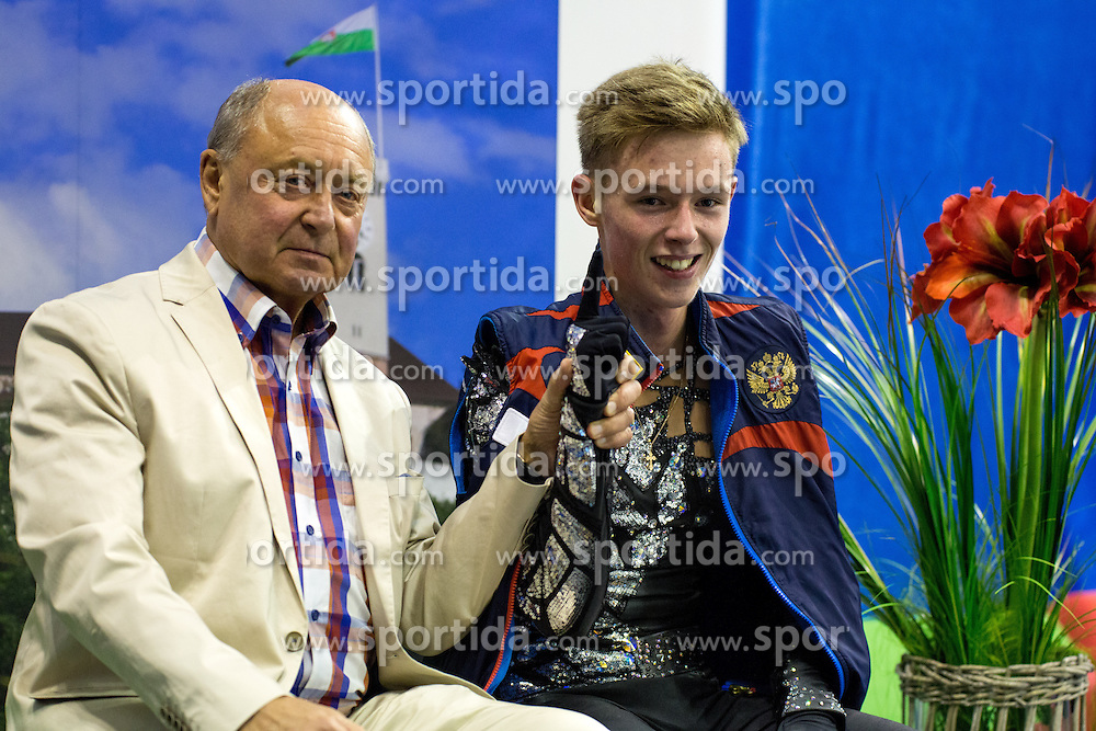 Alexander Petrov of Russia with his coach Alexei Mishin at ISU Junior Grand Prix of Figure Skating Ljubljana Cup 2014 on August 29, 2014 in Hala Tivoli, Ljubljana, Slovenia. Photo by Matic Klansek Velej / Sportida