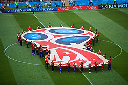 MOSCOW, RUSSIA - Sunday, July 1, 2018: Volunteers unveil a huge World Cup logo banner on the pitch before the FIFA World Cup Russia 2018 Round of 16 match between Spain and Russia at the Luzhniki Stadium. (Pic by David Rawcliffe/Propaganda)
