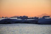 Crystal Sound, Antarctic Peninsula, Antarctica - Icebergs and bergy bits float in Crystal Sound along the Antarctic Peninsula as the sun is sets.<br />  ©Ann Inger Johansson/zReportage/Exclusivexpix media