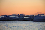 Crystal Sound, Antarctic Peninsula, Antarctica - Icebergs and bergy bits float in Crystal Sound along the Antarctic Peninsula as the sun is sets.<br />  &copy;Ann Inger Johansson/zReportage/Exclusivexpix media