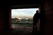 "Maciel Barros contemplates the city and the river in one of the unfinished condominium apartments. In mid-January he will flight to England in search of work, this because ""in Portugal there is no hope for better days"""
