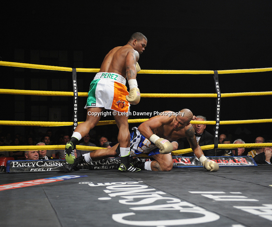 Mike Perez knocks down Gregory Tony in Semi Final 1 at Prizefighter International on Saturday 7th May 2011. Prizefighter / Matchroom. Photo credit © Leigh Dawney. Alexandra Palace, London.
