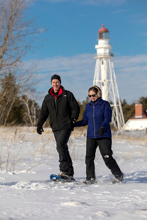 Chris and Amanda Schnell of Manitowoc, Wisconsin snow shoes at Point Beach State Forest near Two Rivers, Wisconsin on 1-17-18. Photo by Mike Roemer