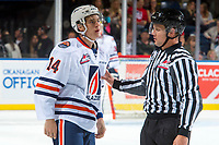 KELOWNA, CANADA - SEPTEMBER 22: Linesman Dustin Minty directs Nic Holowko #14 of the Kamloops Blazers back to the bench after dropping the gloves with the Kelowna Rockets is  on September 22, 2017 at Prospera Place in Kelowna, British Columbia, Canada.  (Photo by Marissa Baecker/Shoot the Breeze)  *** Local Caption ***