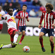 Peguy Luyindula, (left),  New York Red Bulls, is challenged by Agustin Pelletieri, Chivas USA, during the New York Red Bulls V Chivas USA, Major League Soccer regular season match at Red Bull Arena, Harrison, New Jersey. USA. 30th March 2014. Photo Tim Clayton