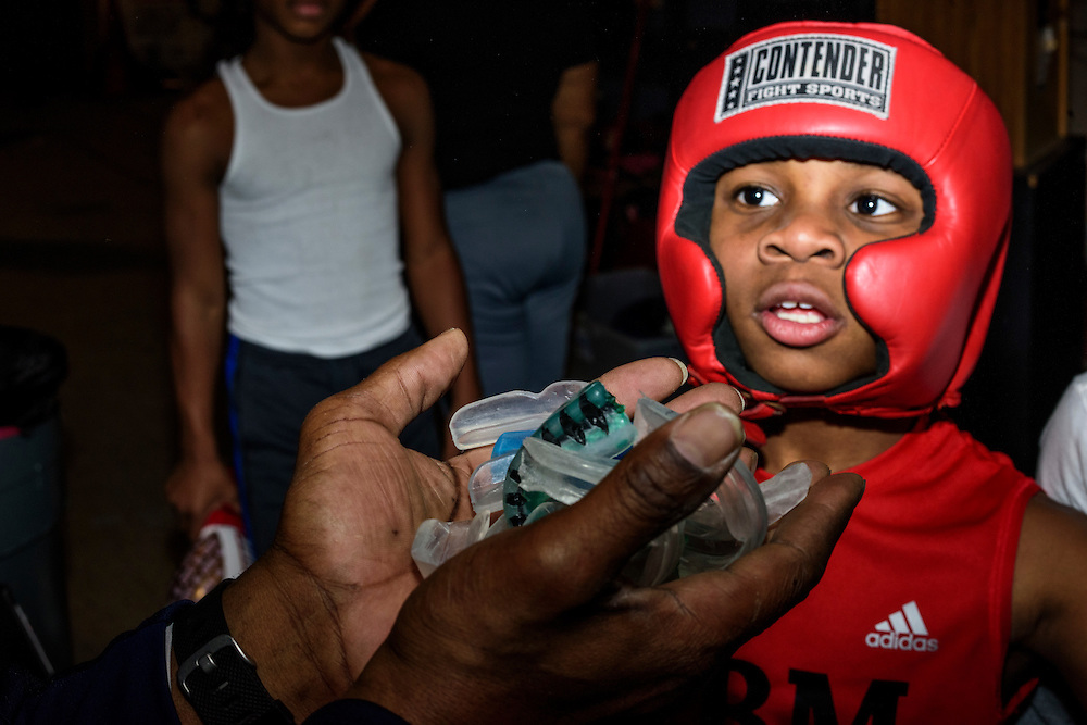 Baltimore, Maryland - January 26, 2017: Upton Boxing Club coach Calvin Ford lectures his boxers about losing their mouth guards before a night of sparring. Nieem &quot;The Brutal Machine&quot; Somerville, 10, stands front and center. <br /> <br /> <br /> CREDIT: Matt Roth for The New York Times<br /> Assignment ID: