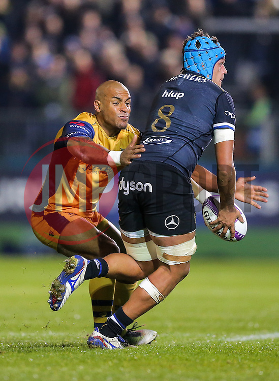 Zach Mercer of Bath Rugby is tackled by Tom Varndell of Bristol Rugby - Rogan Thomson/JMP - 20/10/2016 - RUGBY UNION - The Recreation Ground - Bath, England - Bath Rugby v Bristol Rugby - EPCR Challenge Cup.