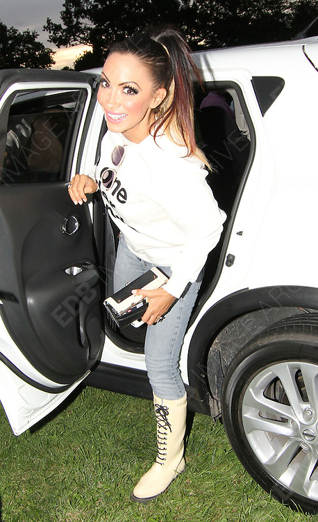 09.AUGUST.2014. ESSEX<br /> <br /> CODE - MAG<br /> <br /> JODIE MARSH SEEN ARRIVING AT THE DRIVE IN TO WATCH GREASE, AT THE BRENTWOOD CENTRE IN ESSEX. JODIE WAS SEEN HAVING HER PHOTO TAKEN OUTSIDE BEFORE THE SHOW.<br /> <br /> BYLINE: EDBIMAGEARCHIVE.CO.UK<br /> <br /> *THIS IMAGE IS STRICTLY FOR UK NEWSPAPERS AND MAGAZINES ONLY*<br /> *FOR WORLD WIDE SALES AND WEB USE PLEASE CONTACT EDBIMAGEARCHIVE - 0208 954 5968*