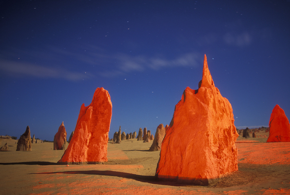 Australia, Western Australia, Red light on limestone pinnacles at night in Nambung National Park near town of Cervantes