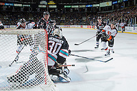 KELOWNA, CANADA - DECEMBER 4: Chad Butcher #21 of Medicine Hat Tigers takes a shot on  net of Michael Herringer #30 of Kelowna Rockets on December 4, 2015 at Prospera Place in Kelowna, British Columbia, Canada.  (Photo by Marissa Baecker/Shoot the Breeze)  *** Local Caption *** Chad Butcher; Michael Herringer;