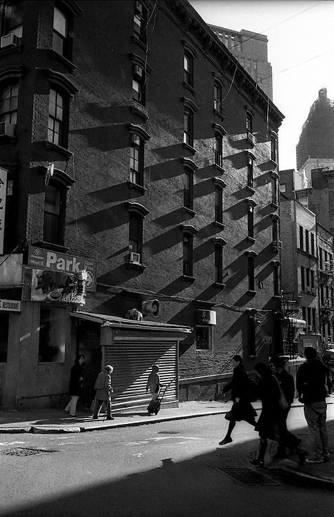 """Street scene in Chinatown / Little Italy...Part of long-term (2005-2008) story """"I See A Darkness"""". New York, NY."""